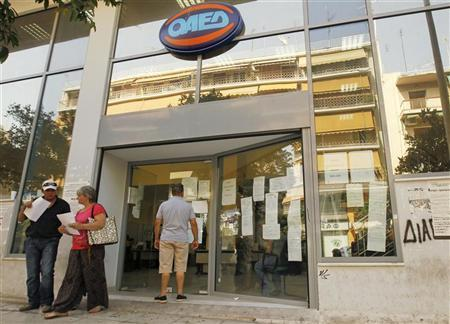 A man checks announcements outside an unemployment bureau in Athens August 9, 2012. REUTERS/Yorgos Karahalis