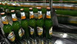 Bottles filled with Zlatopramen radler beer are seen on a conveyor belt in Krusovice Brewery, about 40 miles (64 km) west from Prague, August 12, 2012. REUTERS/Petr Josek
