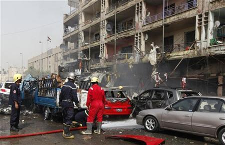 Civil defence personnel work at the site of a bomb attack in central Baghdad July 31, 2012. REUTERS/Saad Shalash
