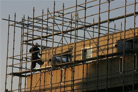 A worker walks at a construction site in Tokyo November 21, 2008. REUTERS/Yuriko Nakao/Files