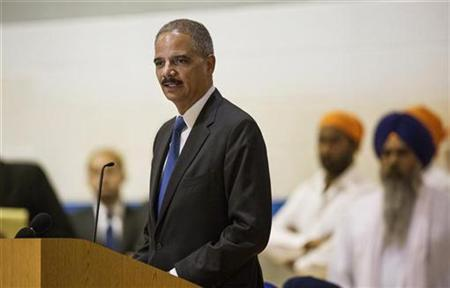 United States Attorney General Eric Holder speaks during the wake and visitation service for victims of last Sunday's attack at a Sikh temple, in Oak Creek, Wisconsin August 10, 2012. REUTERS/Tom Lynn