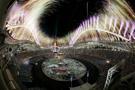 PICTURES OF THE YEAR 2004 - Fireworks explode over the Olympic stadium during the opening ceremony of the Athens 2004 Olympic Games August 13, 2004. A spectacular opening ceremony launched the Athens Olympics on Friday, lifting spirits in the Games' ancient birthplace. REUTERS/Yannis Behrakis