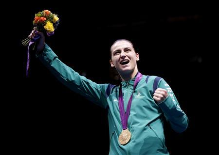 Gold medallist Katie Taylor of Ireland celebrates during the presentation ceremony for the Women's Light (60kg) boxing competition at the London Olympic Games in this August 9, 2012 file photograph. REUTERS/Murad Sezer/Files