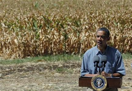 U.S. President Barack Obama speaks after he tours the McIntosh family farm with the owners to view drought ridden fields of corn in Missouri Valley, Iowa, August 13, 2012. REUTERS/Larry Downing