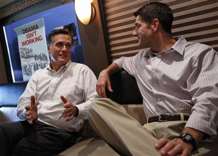 Republican U.S. presidential candidate Mitt Romney (L) speaks with vice president running mate U.S. Congressman Paul Ryan (R-WI) on their campaign bus before a campaign event in Waukesha, Wisconsin August 12, 2012. REUTERS/Shannon Stapleton