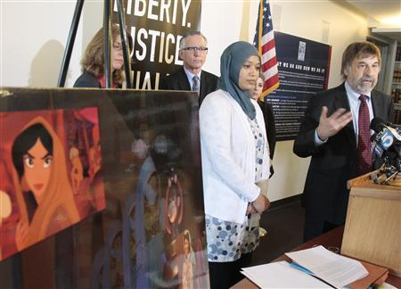American Civil Liberties Union (ACLU) Chief Council Mark Rosenbaum (R) speaks as former Disney employee Imane Boudlal, (2nd R) looks on as they announce a federal lawsuit against Disney alleging discrimination and harassment because of her religious beliefs at ACLU headquarters in Los Angeles, California August 13, 2012. REUTERS/Jason Redmond