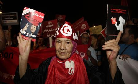 Protester shout slogans during a demonstration in Tunis August 13, 2012. Thousands of Tunisians rallied on Monday to protest against what they see as a push by the Islamist-led government for constitutional changes that would degrade women's status in one of the Arab world's most liberal nations. REUTERS-Zoubeir Souissi