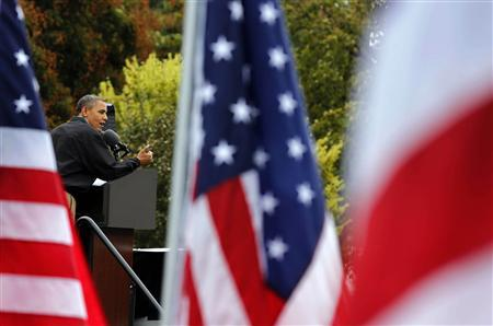 U.S. President Barack Obama delivers remarks at a campaign event at Bayliss Park in Council Bluffs, Iowa, August 13, 2012. REUTERS/Larry Downing