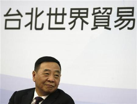China Vice Commerce Minister Chen Jian attends a forum on cross-strait business strategies after the ECFA trade deal in Taipei September 27, 2010. The Chinese characters read, ''Taipei World Trade.'' REUTERS/Pichi Chuang