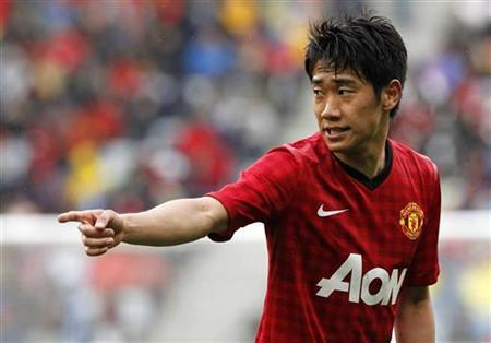 Shinji Kagawa gestures during their friendly match against Ajax Cape Town at the Cape Town Stadium, July 21, 2012. REUTERS/Mike Hutchings