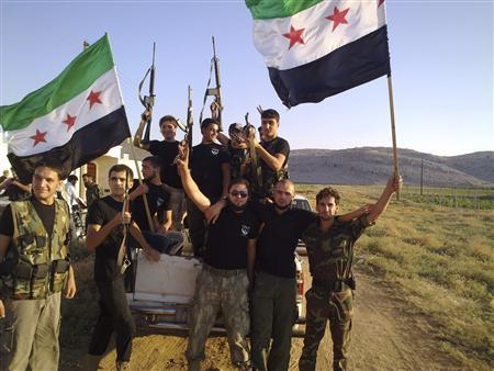 Members of Free Syrian Army fighters holding their weapons and opposition flags are pictured at Sermada near Idlib August 12, 2012. Picture taken August 12, 2012. REUTERS/Shaam News Network/Handout