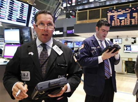 Traders work on the floor of the New York Stock Exchange, July 31, 2012. REUTERS/Brendan McDermid