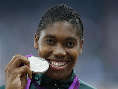 South Africa's Caster Semenya reacts after receiving her silver medal during the women's 800m victory ceremony at the London 2012 Olympic Games at the Olympic Stadium August 11, 2012. REUTERS/Eddie Keogh