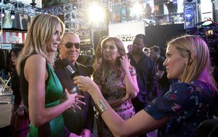 (L-R) Model Heidi Klum, designer Michael Kors and Nina Garcis speak to the media at the ''Project Runway'' 10th Anniversary Outdoor Runway Event at Times Square in New York June 15, 2012. REUTERS/ Andrew Kelly