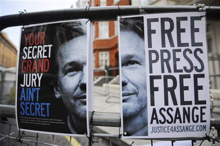 A barrier with a Free Assange posters are seen opposite the Ecuadorean Embassy in London August 14, 2012. REUTERS/Ki Price