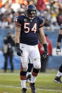 Chicago Bears middle linebacker Brian Urlacher walks off the field after the Seattle Seahawks scored a touchdown during the fourth quarter of their NFL football game at Soldier Field in Chicago December 18, 2011. REUTERS/Frank Polich