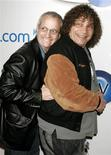 "Actors Ron Palillo (L) and Robert Hegyes, best known for their portrayals of Arnold Horshack and Juan Epstein in the 1970s TV comedy series ""Welcome Back, Kotter"", pose at the launch party for In2TV in Beverly Hills, California in this March 15, 2006 file photograph. REUTERS/Fred Prouser/Files"