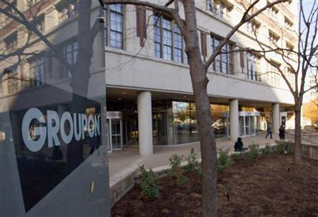 People enter and leave Groupon Inc corporate office and headquarters in Chicago, Illinois, November 4, 2011. REUTERS/Frank Polich