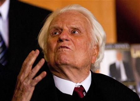 Billy Graham gestures while attending a book signing for former U.S. President George W. Bush's new book ''Decision Points'' at the Billy Graham Library in Charlotte, North Carolina December 20, 2010. REUTERS/Chris Keane