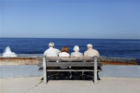 A pair of elderly couples view the ocean and waves along the beach in La Jolla, California in this March 8, 2012, file photo. REUTERS/Mike Blake/Files