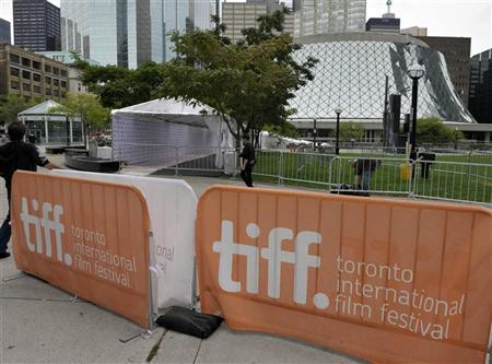 Workers prepare the red carpet area at Roy Thomson Hall for the start of the 36th Toronto International Film Festival in Toronto September 7, 2011. The TIFF runs from September 8-18. REUTERS/Mike Cassese