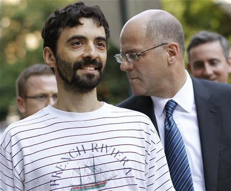 Former Goldman Sachs computer programmer Sergey Aleynikov (L) smiles as he exits Manhattan Criminal Court in New York, August 9, 2012. REUTERS/Brendan McDermid
