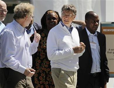 Bill Gates (R) and former Microsoft chief technology officer and co-founder of Intellectual Ventures Nathan Myhrvold (L) speak while reviewing the displays at the ''Reinvent the Toilet Fair'' competition at the Bill and Melinda Gates Foundation campus in Seattle, Washington on August 14, 2012. REUTERS/Anthony Bolante