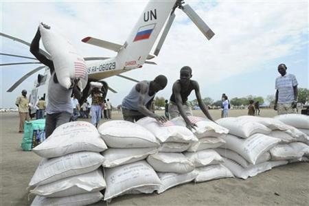 Boxes and sacks of food are unloaded from a U.N. helicopter in Pibor January 12, 2012. REUTERS/Isaac Billy/UNMISS/Handout