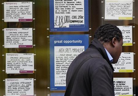 A man looks at job advertisements in the window of a recruitment agency in Liverpool, northern England November 16, 2011. REUTERS/Phil Noble