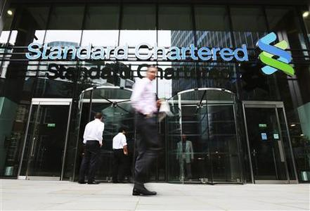 An exterior view of the Standard Chartered headquarters is seen in London in this August 7, 2012, file photo. REUTERS/Olivia Harris/Files