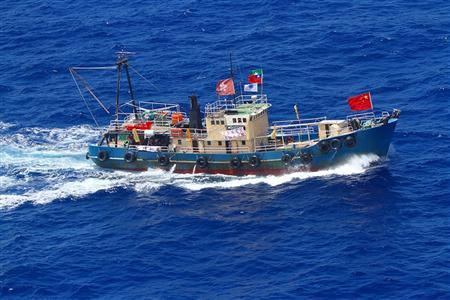 A fishing boat carrying activists from the Hong Kong-based ''Action Committee for Defending the Diaoyu Islands'' sails near the disputed islands in the East China Sea, known as Senkaku in Japan or Diaoyu in China, in this handout photo taken by the Japan Coast Guard on August 15, 2012. REUTERS/11th Regional Coast Guard Headquarters-Japan Coast Guard/Handout
