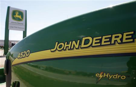 A new John Deere tractor waits for a buyer at a dealer in Longmont, Colorado in this August 18, 2010 file photo. REUTERS/Rick Wilking/Files
