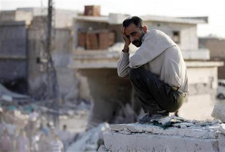A man reacts in front of houses destroyed during a recent Syrian Air Force air strike in Azaz, some 47 km (29 miles) north of Aleppo, August 15, 2012. REUTERS/Goran Tomasevic