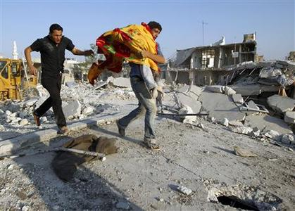 A man carries the body of a boy after a Syrian Air force air strike in Azaz, some 47 km (29 miles) north of Aleppo, August 15, 2012. REUTERS/Goran Tomasevic