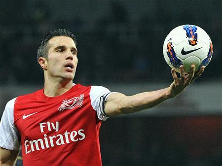 Arsenal's Robin van Persie catches the ball during their Premier League match against Newcastle United at Emirates Stadium in London March 12, 2012. REUTERS/Toby Melville