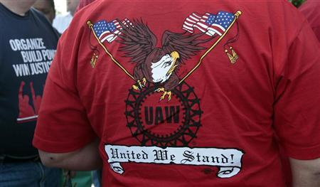 A United Auto Workers union member wears a shirt with 'UAW United We Stand' on it during a ceremony where members of UAW Local 600 unfurled a banner to commemorate the 75th anniversary of the historic ''Battle of the OverPass'' in Dearborn, Michigan May 25, 2012. REUTERS/Rebecca Cook