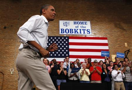 U.S. President Barack Obama prepares to speak at a campaign event at the B.R. Miller Middle School in Marshalltown, Iowa, August 14, 2012. REUTERS/Larry Downing