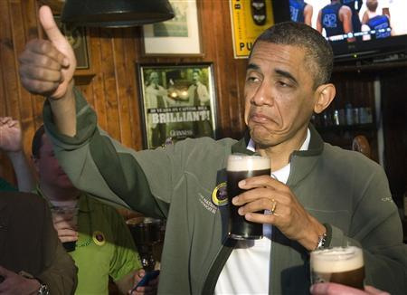 U.S. President Barack Obama gives a thumbs-up as he celebrates St. Patrick's Day in Washington in this file photo taken March 17, 2012. REUTERS/Jonathan Ernst/Files