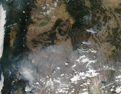 NASA handout satellite image taken on August 13, 2012 shows fires burning in California, Nevada and Oregon. Wildfires roared out of control across the sun-scorched U.S. West on August 15 and threatened to roll into two small towns in Idaho as firefighters managed to partially dampen a monster blaze that has destroyed 60 homes in Washington state. REUTERS-NASA-Jeff Schmaltz-LANCE-EOSDIS MODIS Rapid Response Team-GSFC-Handout