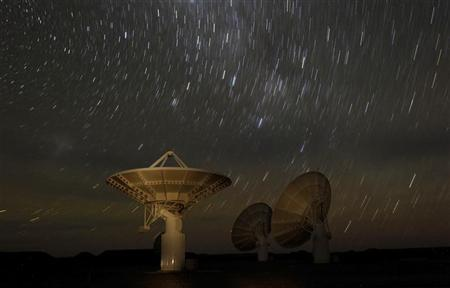 Star trails form over radio telescope dishes in a long exposure picture taken in South Africa, May 17, 2012. REUTERS/Mike Hutchings