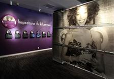 "A large photograph of the late singer Whitney Houston posing with a Grammy Award is pictured during a press preview of the new exhibit ""Whitney! Celebrating The Musical Legacy of Whitney Houston"", at The Grammy Museum in Los Angeles, California August 15, 2012. REUTERS/Fred Prouser"