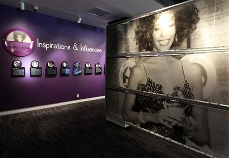 A large photograph of the late singer Whitney Houston posing with a Grammy Award is pictured during a press preview of the new exhibit ''Whitney! Celebrating The Musical Legacy of Whitney Houston'', at The Grammy Museum in Los Angeles, California August 15, 2012. REUTERS/Fred Prouser