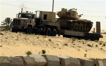 An Egyptian army truck carries tanks and vehicles to Rafah city, some 350 km (217 miles) northeast of Cairo, August 10, 2012. REUTER/Mohamed Abd El Ghany