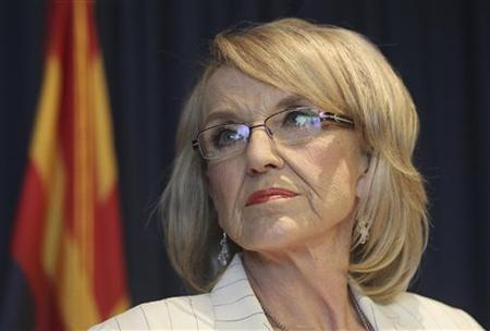 Arizona Governor Jan Brewer listens to a question from a media member about the Supreme Court's decision on SB1070 in Phoenix, Arizona, June 25, 2012. REUTERS/Darryl Webb