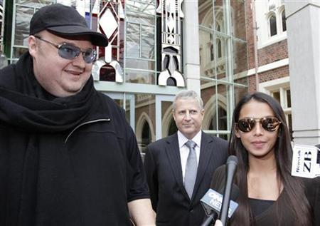 Megaupload founder Kim Dotcom (L) stands next to his wife Mona as he talks to members of the media after he left the High Court in Auckland February 29, 2012. REUTERS/Simon Watts