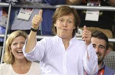 Paul McCartney celebrates after Britain's Dani King, Laura Trott and Joanna Rowsell won the track cycling women's team pursuit gold finals at the London 2012 Olympic Games August 4, 2012. REUTERS/Stefano Rellandini