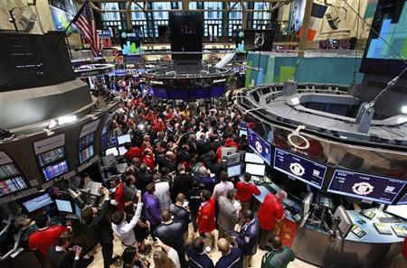 People gather at the post for the start of trading of Manchester United Ltd following its initial public offering on the floor of the New York Stock Exchange, August 10, 2012. REUTERS/Brendan McDermid