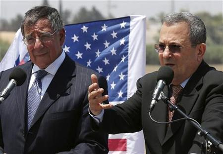 Israeli Defense Minister Ehud Barak (R) and U.S. Defense Secretary Leon Panetta speak to the media at a joint news conference while visiting the Iron Dome defense system launch site in Ashkelon August 1, 2012. REUTERS/Mark Wilson/Pool
