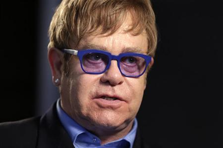 Musician Elton John speaks during an interview in Washington July 23, 2012. John was in town to speak at the AIDS 2012 conference. REUTERS/Kevin Lamarque