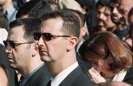 Bashar al-Assad (C), his younger brother Maher (L) and sister Bushra during the funeral of their father Hafez al-Assad. Reuters/ Stringer.